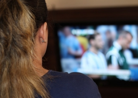 A woman spending time watching TV.