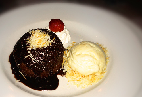 chocolate molten cake wth creme brulee ice cream on the side