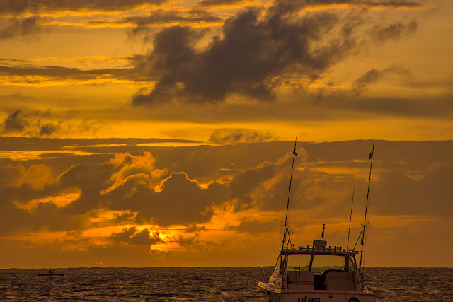 deep-sea fishing boat in the sunset