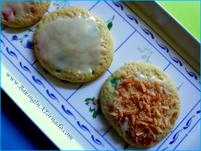 Tropical Storm Cookies: a soft cookie with the hint of a pineapple filled with soft tropical flavored candy, glazed and topped with toasted pineapple | Recipe developed by www.BakingInATornado.com | #recipe #cookies