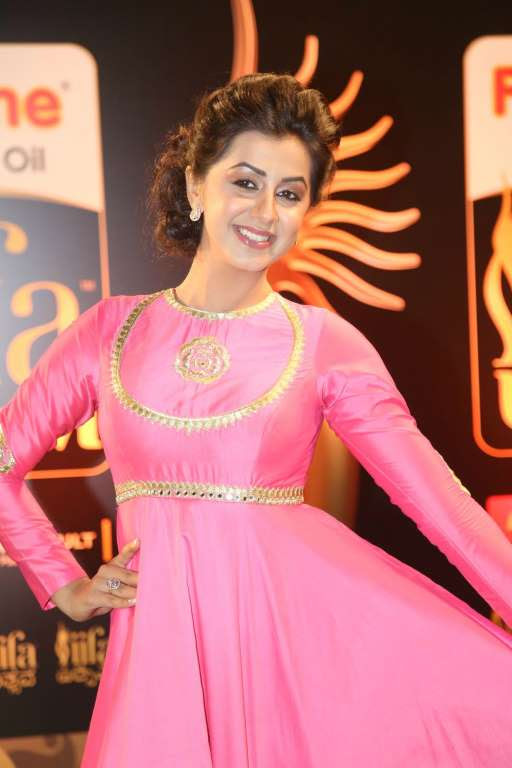 Nikki Galrani poses for photographers upon arrival at IIFA Utsavam