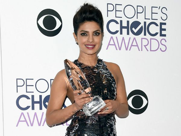 priyanka chopra with trophy prize people's choice favorite actress in a new tv series quantico as alex parrish