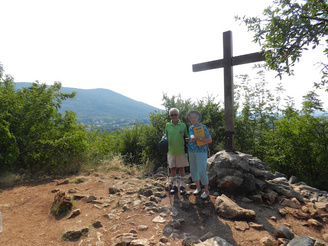 John and Charlotte at the wooden Cross on Apparition Hill