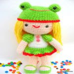 http://www.craftsy.com/pattern/crocheting/toy/kelly-girl-with-frog-hat-crochet-ami/13403?rceId=1447967529617~guj87q1g