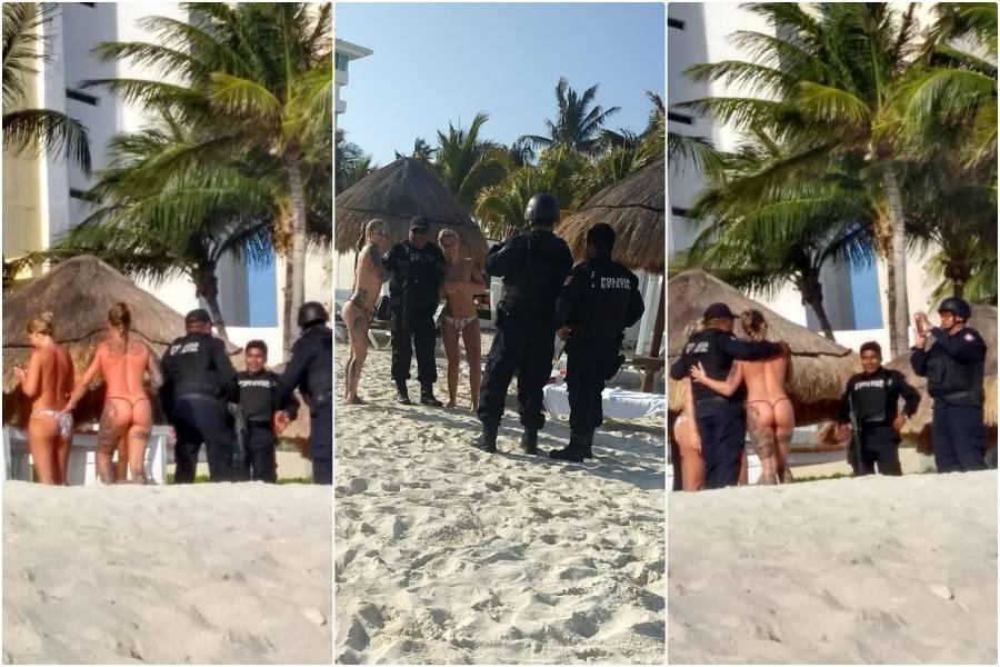 Image result for policias se fotografian con turistas topless