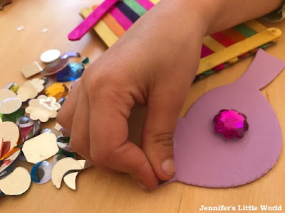 Child using Bostik products for crafting