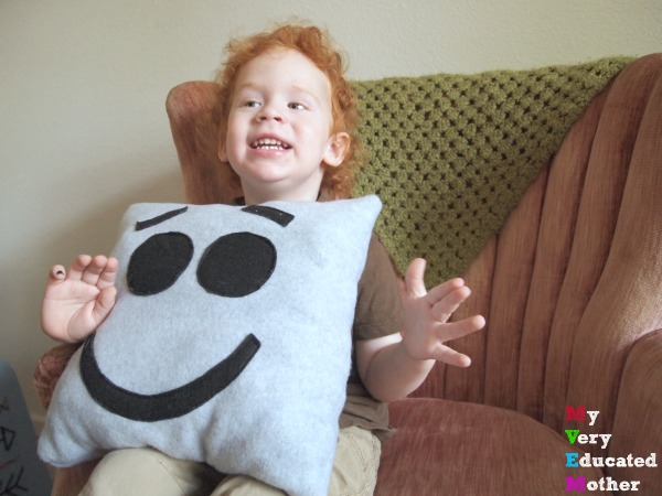 "Des is ""HAPPY"" with his Emoji pillow he's able to better express his toddler self!"