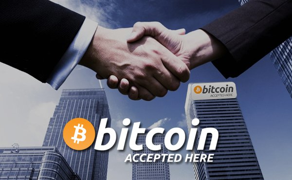 Business and Consumer shaking hand accepting bitcoin