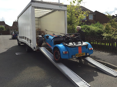 Ian loading the R500 onto the Caterham lorry to take it back for annual servicing