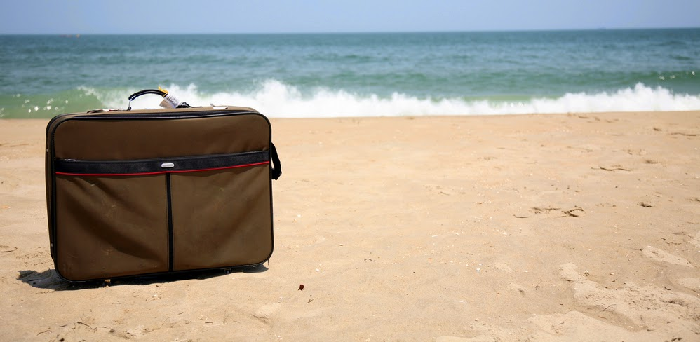 Suitcase on a beach.