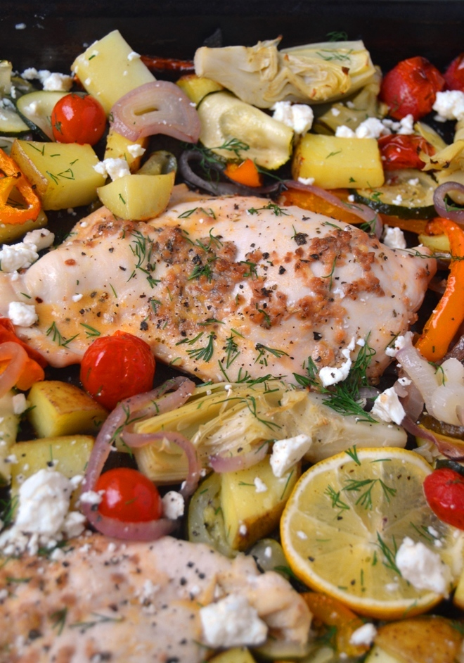 Sheet Pan Greek Chicken and Vegetables is a delicious one-pan meal with roasted potatoes, onions, bell peppers, tomatoes, zucchini, artichokes and feta cheese with dill, lemon and garlic. www.nutritionistreviews.com