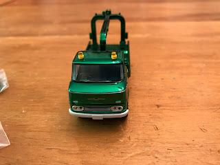 tlv green chrome nissan wrecker truck