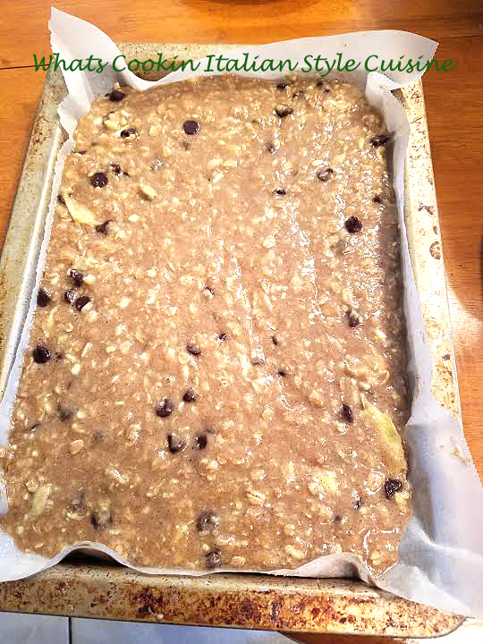 Zucchini Chocolate Chip Bar are a bar kind of cake square with zucchini and chocolate chips added to the batter . These are in a brownie rectangular pan and cut in square You can see how moist they are in the photo
