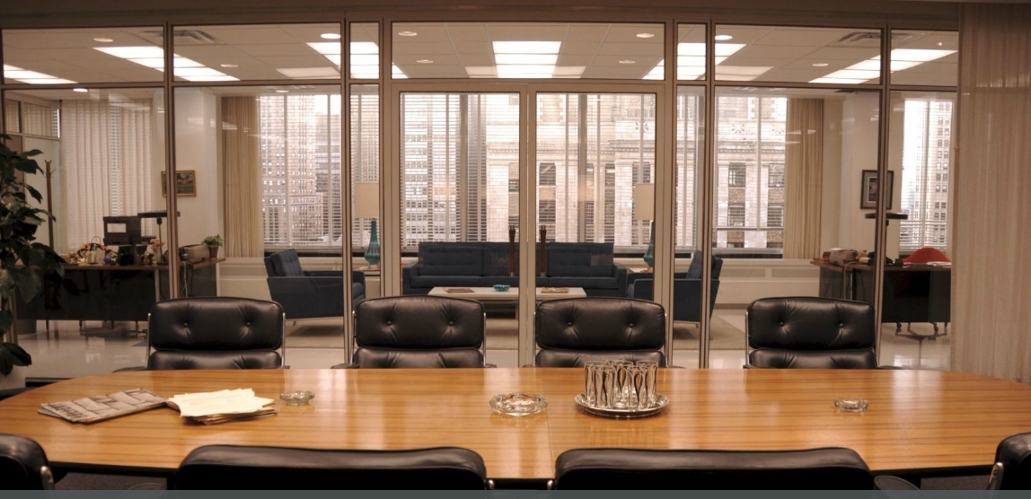 The sleek lines and leather chairs in this Mad Men office space are 60s style.