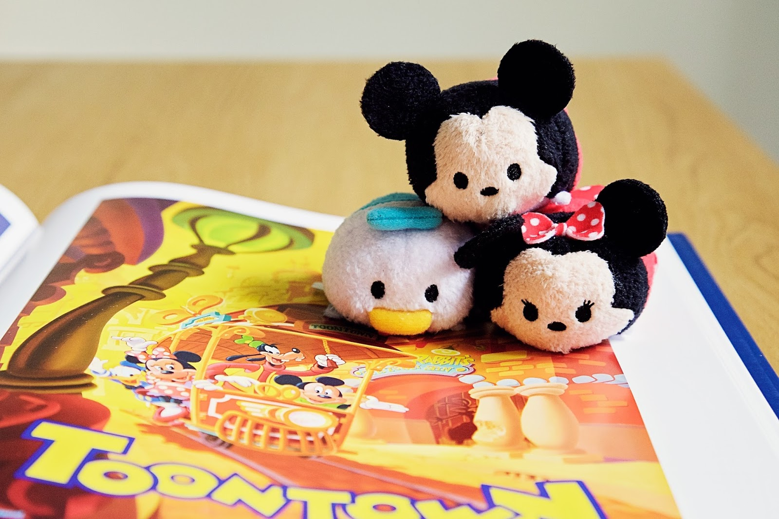 Disney Mickey, Minnie, and Donald Tsum Tsums on top of Mickey and Friends image.