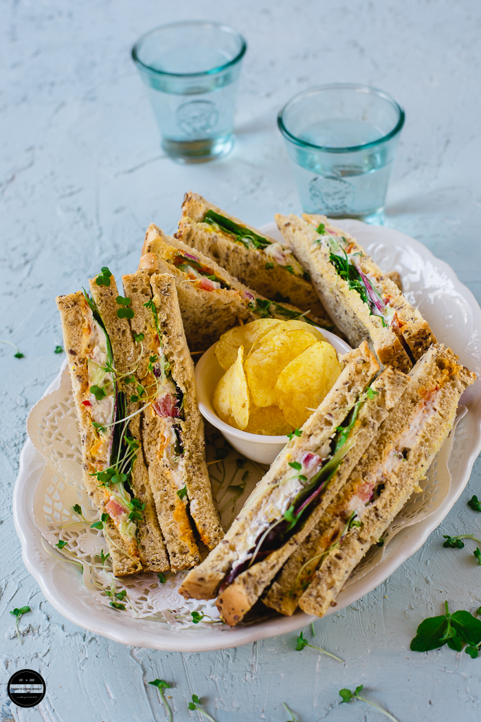 Yogurt and Herb Summer sandwich is a healthy and delicious meal that is prepared with bread slices, yogurt spread and fresh salad.