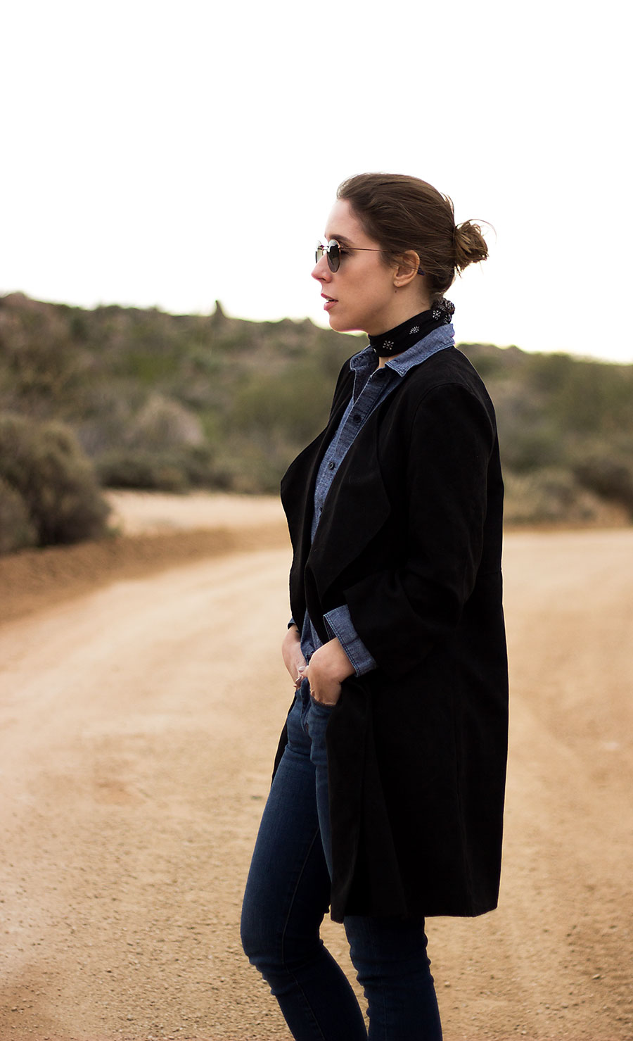Denim outfits, desert outfit, what to wear to the desert, denim on denim outfit, how to style denim on denim, western booties, black booties, long black jacket, Phoenix, Arizona, Desert photography, desert outfit, all denim outfit, bandana around neck, how to style a bandana