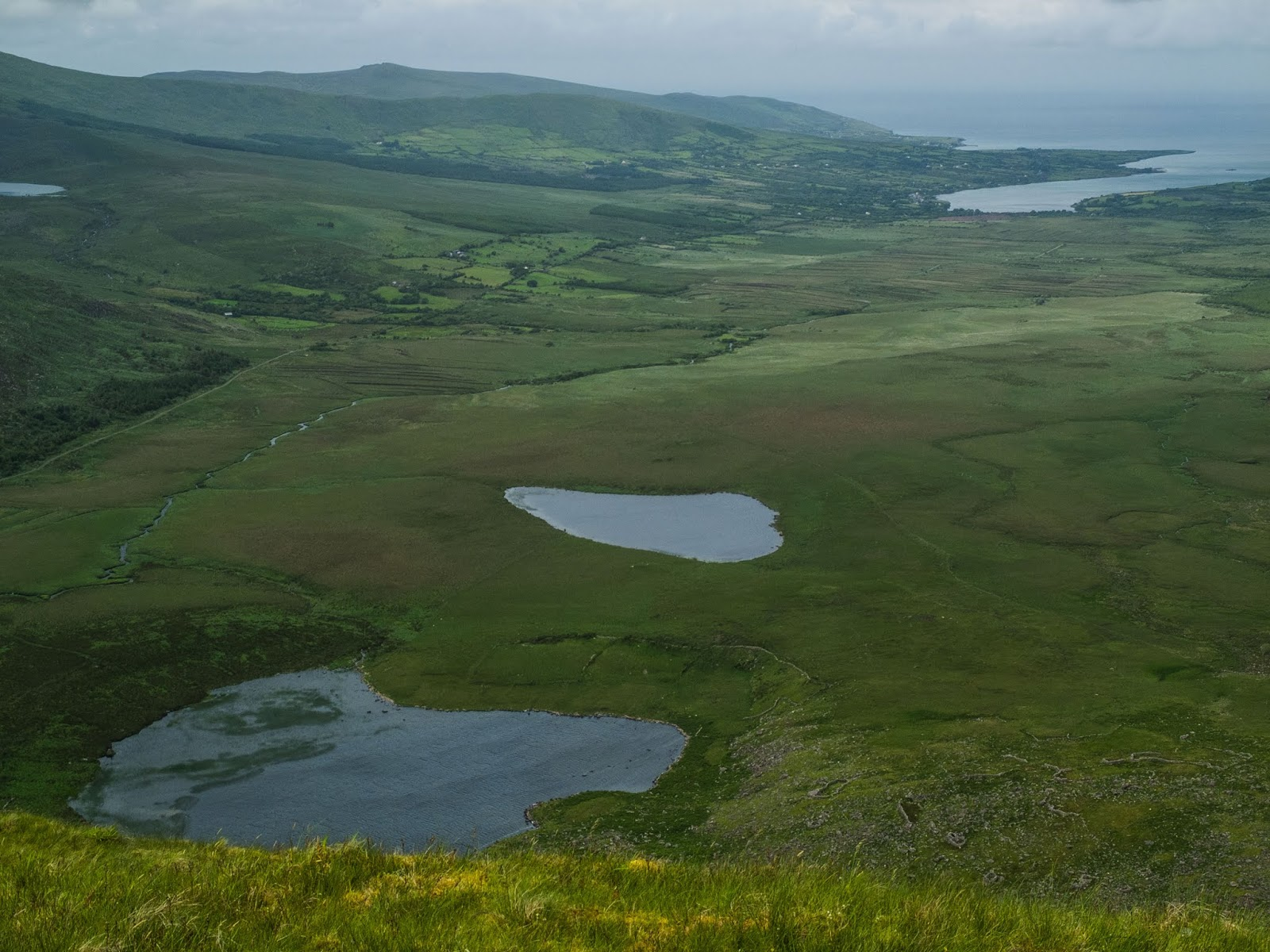 View of Clogharee Lough and Lough Atlea from Conor Pass in County Kerry.