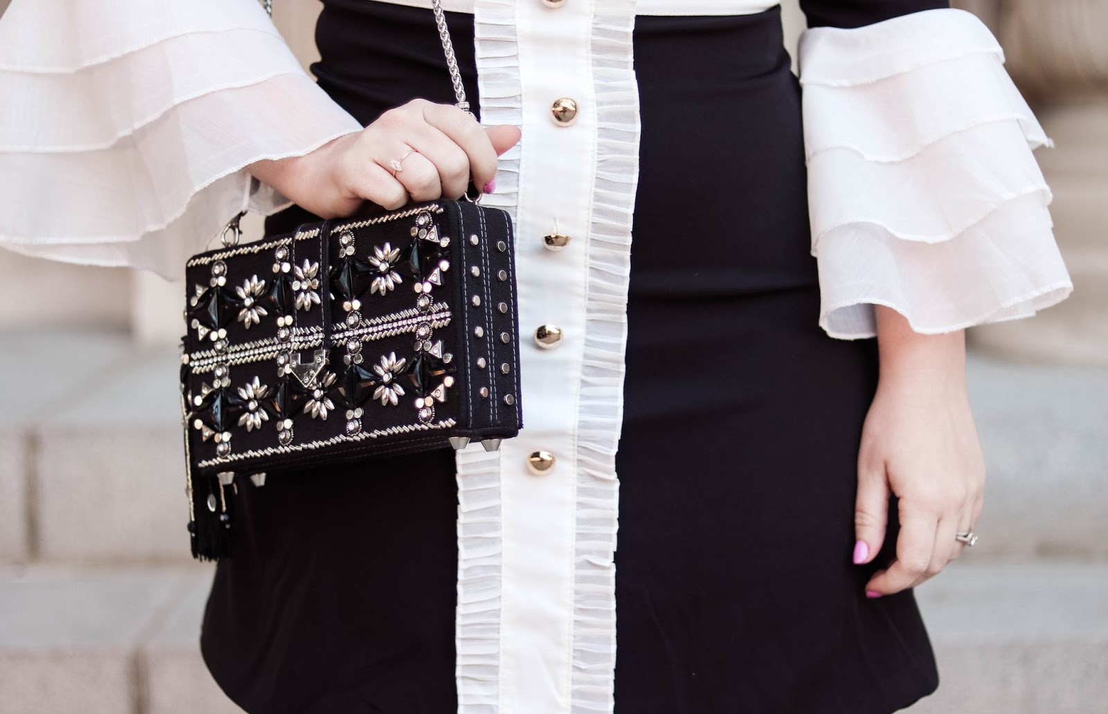 Elizabeth Hugen of Lizzie in Lace wears a black and white ruffled dress