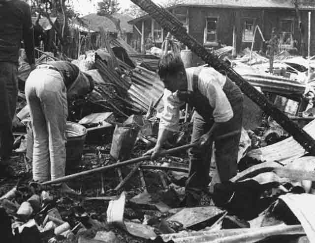 Cleaning up wreckage on Hawaii, 17 December 1941 worldwartwo.filminspector.com