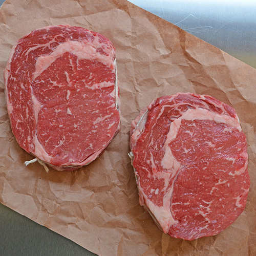 How to grill competition style ribeye steaks on a charcoal grill.  Start with Certified Angus Beef! #steakholder.