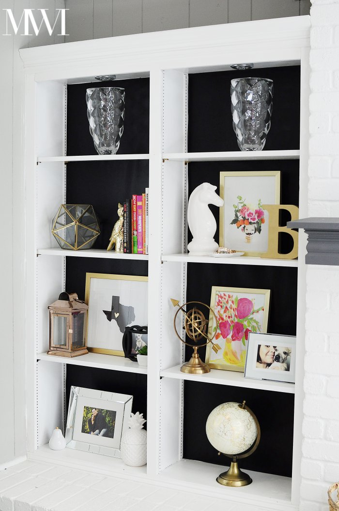 This black backed/lined bookcase looks fabulous and requires NO painting! The blogger uses contact paper to completely makeover her bookcase. The end result is so chic! (via monicawantsit.com)
