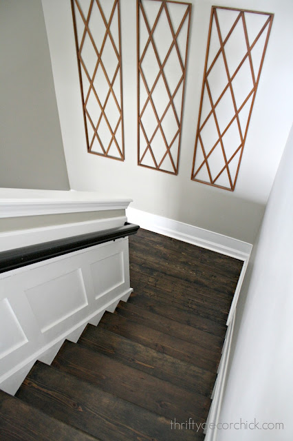 Dark wood steps, white trim