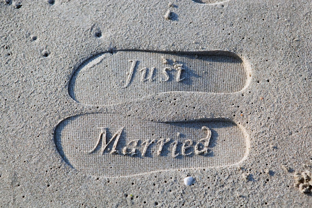 Honeymoon- Just Married Foot Prints on Sandy Beach