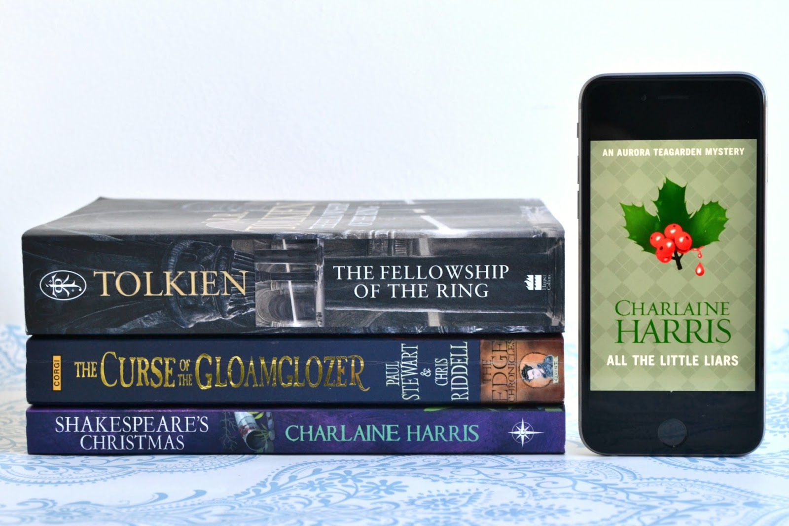 The Fellowship of the Ring by J. R. R. Tolkien, The Curse of the Gloamglozer by Paul Stewart & Chris Riddell, Shakespeare's Christmas and  All The Little Liars by Charlaine Harris