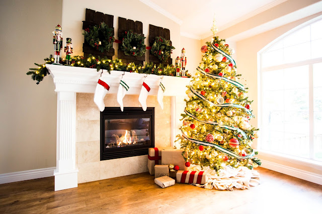 diy christmas mantle, fireplace, nutcrackers, garland, lights, candles