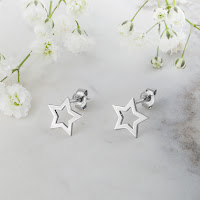Solid gold star stud earrings in 14k white gold