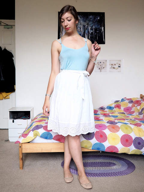 Cinderella Disneybound outfit of pale blue top, floaty white skirt & nude flat shoes