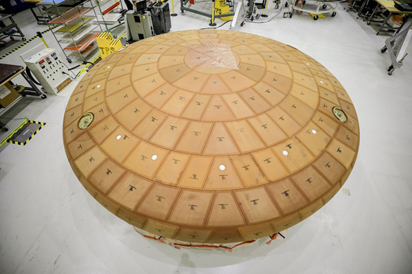 The heat shield for the Orion Artemis 2 spacecraft on display at NASA's Kennedy Space Center in Florida.