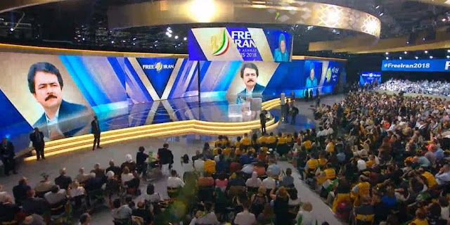 Image Attribute: Free Iran 2018 Gathering, Hosted by People's Mojahedin Organization of Iran or the Mojahedin-e Khalq (MEK) / Source: Video Screengrab