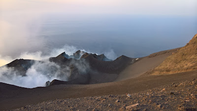 Craters of Stromboli volcano just before sunset.