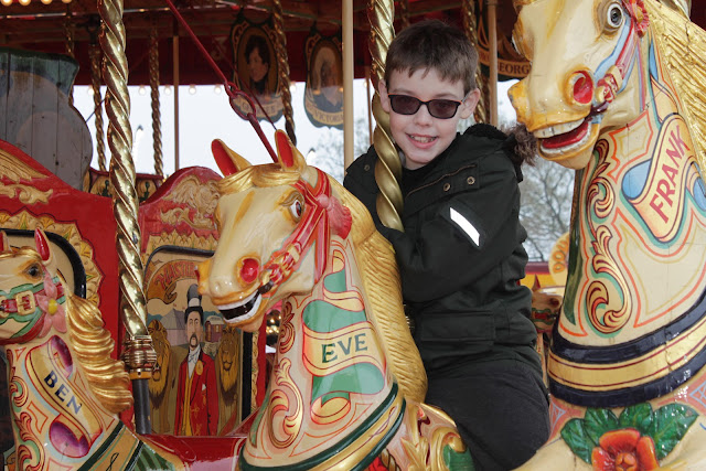 My nephew enjoying himself on the Carters Steam Fair Gallopers ride.
