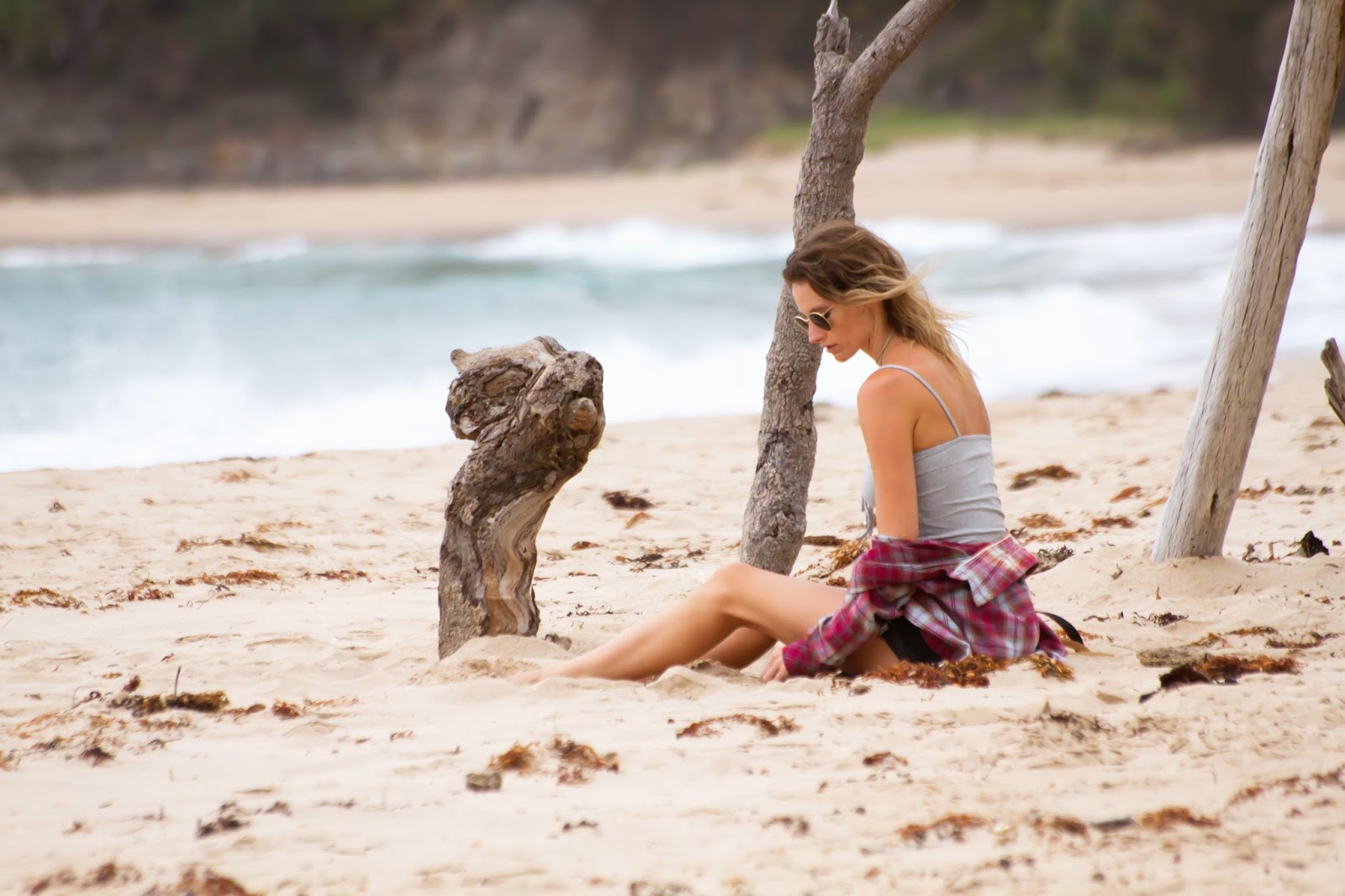 fashion and travel blogger, Alison Hutchinson, at Pebbly Beach, NSW Australia