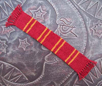 Tiny scarves in Hogwarts house colors make a perfect bookmark to keep your spot in our favorite wizard series.