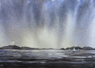 A water colour painting of a monsoon sky on handmade paper