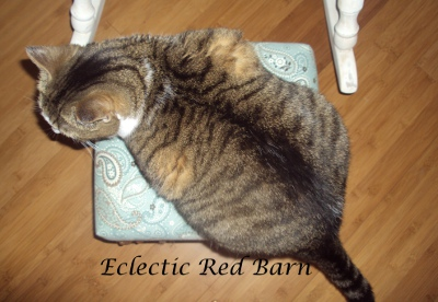 Eclectic Red Barn: Claire on top of the foot stool