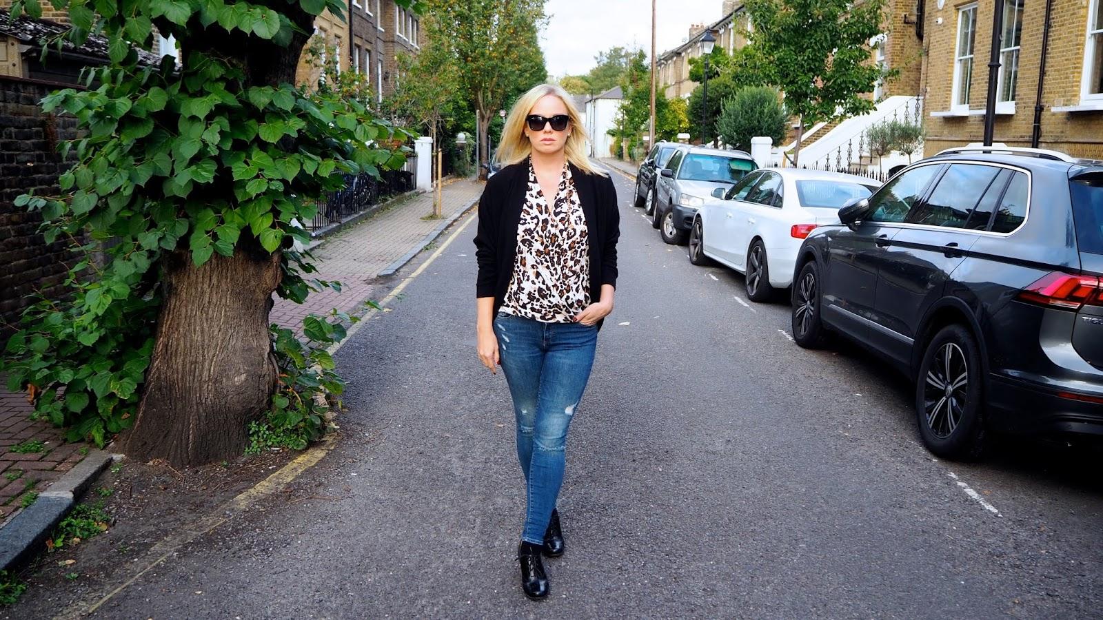 Leopard print top, distressed jeans, black brogues, black cardigan, black sunglasses