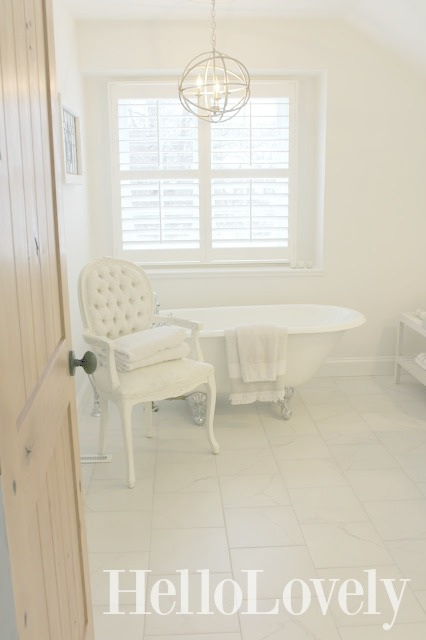 image result for Hello Lovely Studio Chicago fixer upper master bathroom white plantation shutters clawfoot tub