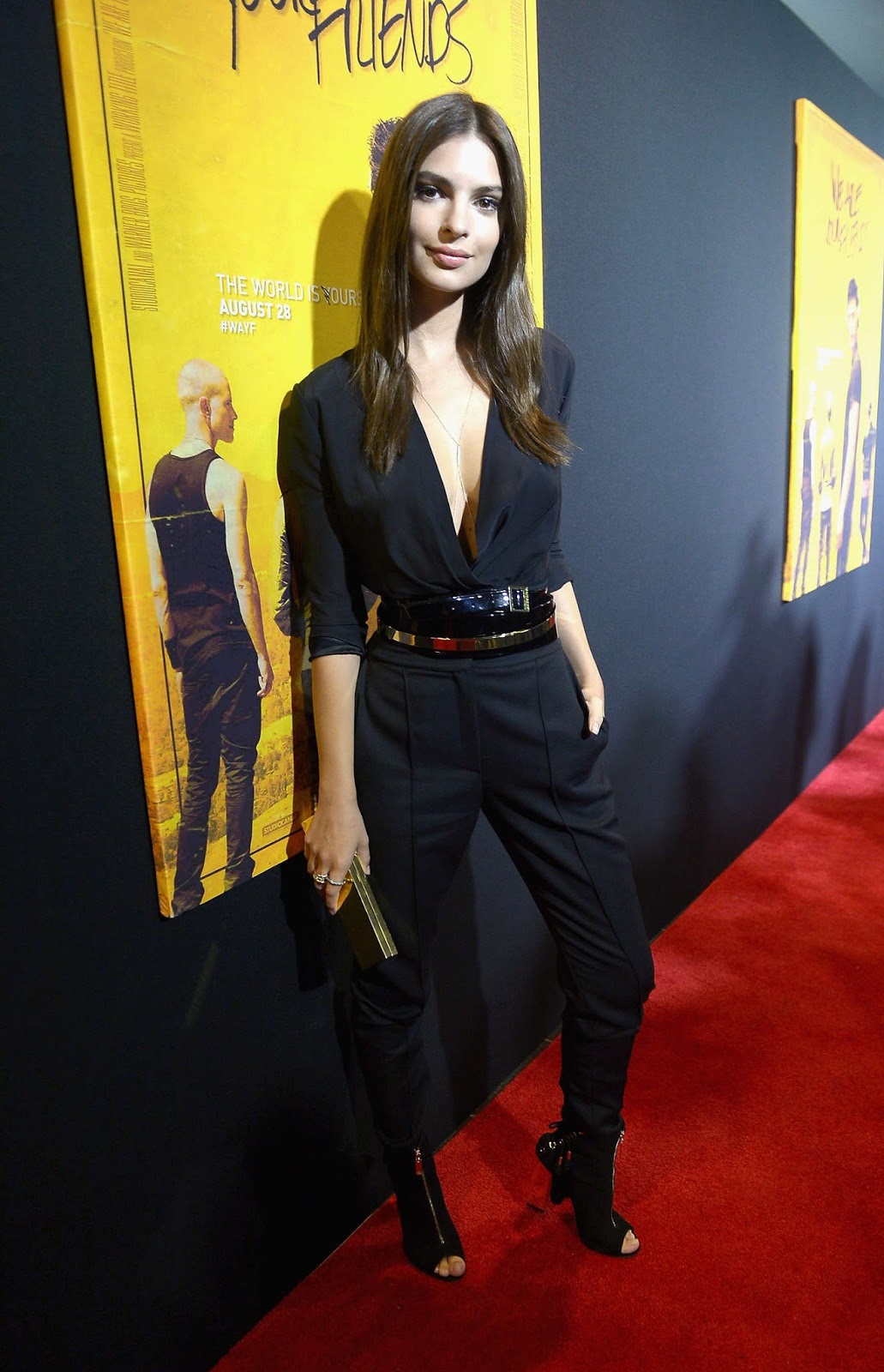 Emily Ratajkowski flaunts side-boob in plunging black jumpsuit at We Are Your Friends premiere