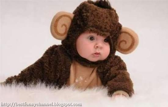 Funny baby in monkey costume