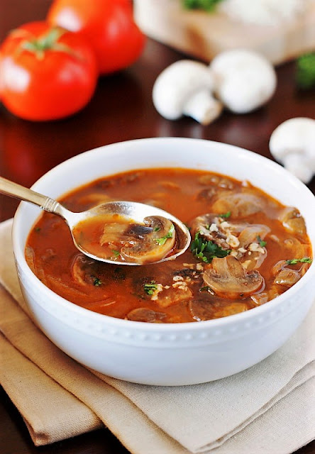 Homemade Tomato-Mushroom Soup image ~ Loaded with fresh mushrooms and full of rich and delicious flavor, this warm, comforting, and tasty soup is the kind of good food that just makes you feel good all over.