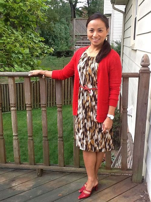 street style: chic work wear outfit with brown dress and red cardigan