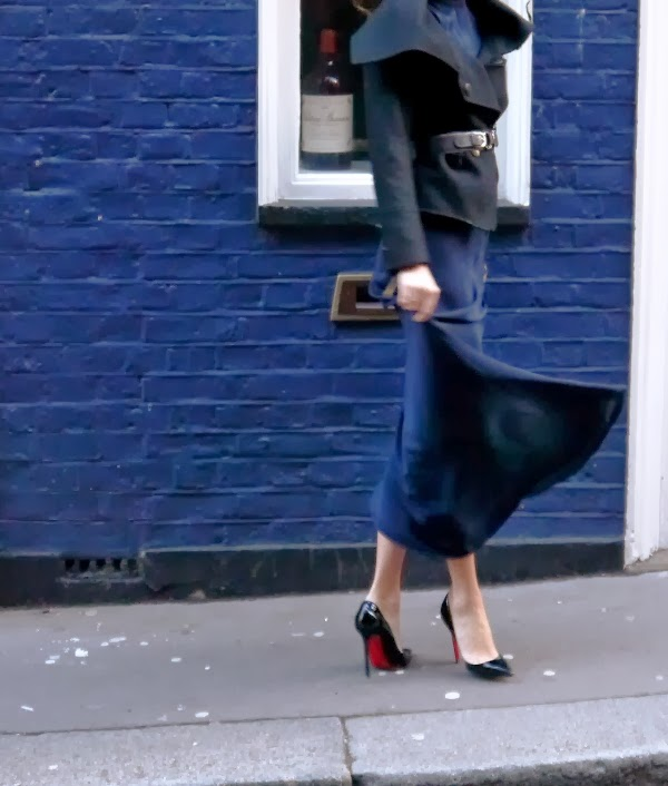 Black wool jacket over navy blue maxi dress with Christian Louboutin Pigalle stilettos