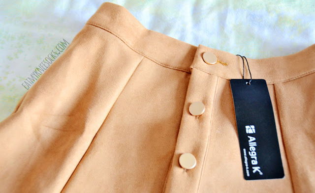 Details on the tan faux suede button-down a-line skirt from Allegra-K.