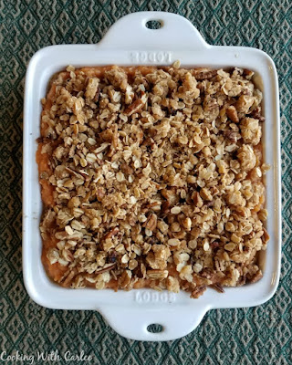 square casserole dish pile high with oatmeal and pecan crunch topping showing