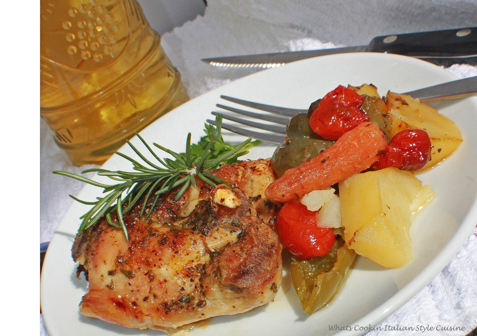 Italian chicken with potatoes, carrots, peppers and tomatoes baked in the oven until crispy